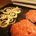 Burger and onions on the raclette grill