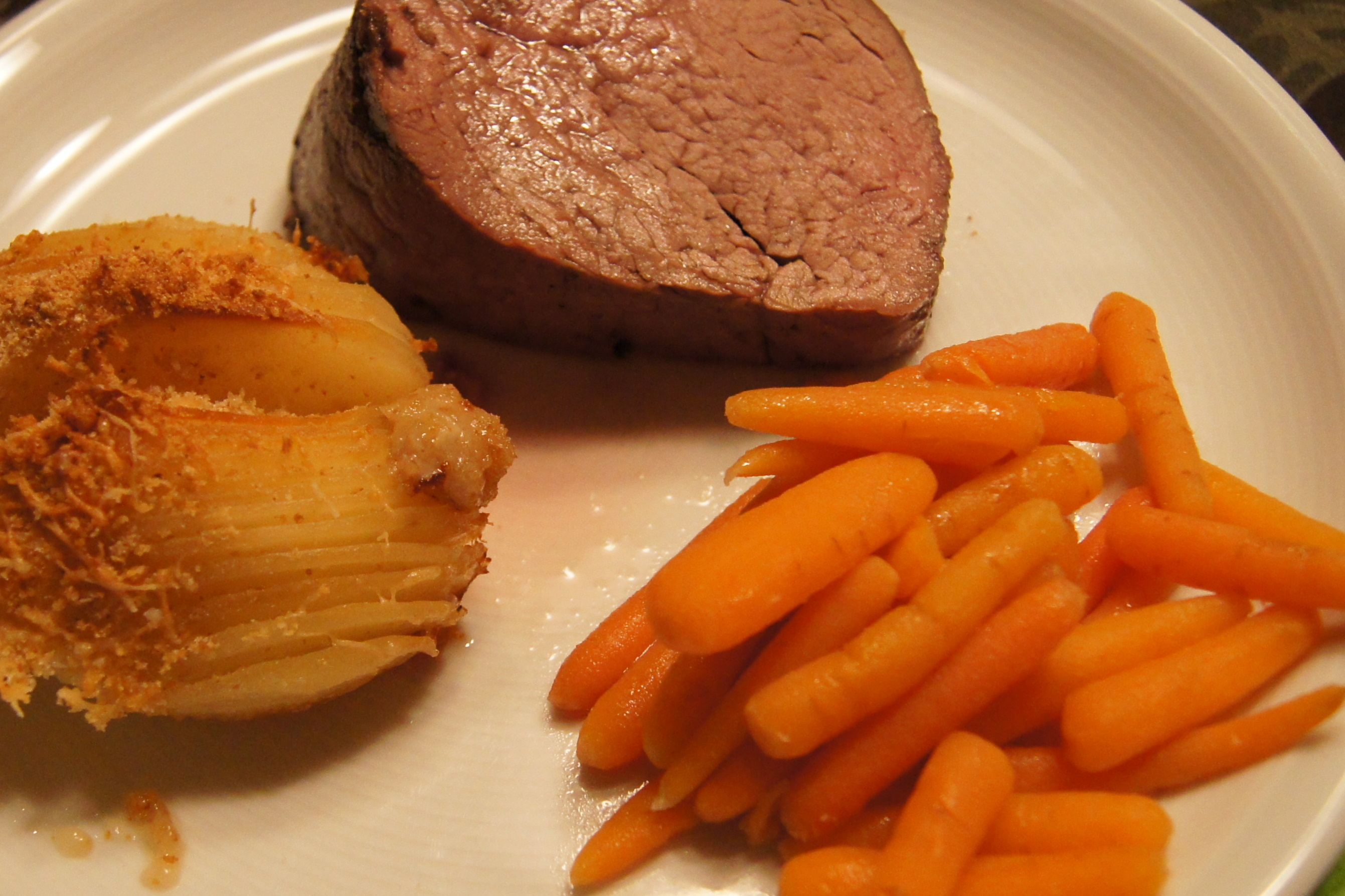 Beef Tenderloin, Accordion Potatoes, and Sugar glazed Baby Carrots